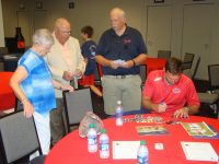 Jeff Francoeur signs baseball cards for All-Stars